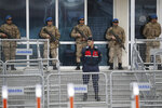 Soldiers stand behind a barricaded entrance of the Silivri courthouse, before the trial of leading members of Turkish civil society, in Silivri, outside Istanbul, Tuesday, Feb. 18, 2020. The trial of 16 leading members of Turkish civil society that is seen by critics as a momentous bid by the government to crack down on opposition voices and criminalize mass anti-government protests is moving toward a hasty conclusion. (AP Photo/Emrah Gurel)