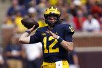 Michigan quarterback Cade McNamara (12) throws against Northern Illinois in the first half of a NCAA college football game in Ann Arbor, Mich., Saturday, Sept. 18, 2021. (AP Photo/Paul Sancya)
