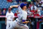 Texas Rangers starting pitcher Kolby Allard throws to a Los Angeles Angels batter during the first inning of a baseball game in Anaheim, Calif., Saturday, Sept. 4, 2021. (AP Photo/Ringo H.W. Chiu)
