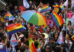People celebrate on the street in central Istanbul, during a Pride march event in Istanbul, Sunday, June 30, 2019. Activists gathered in Istanbul to promote rights for gay and transgender people Sunday before police dispersed the crowd at a pride event that Turkish authorities had banned for the fifth year. (AP Photo/Lefteris Pitarakis)