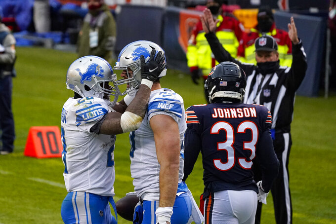 Detroit Lions tight end Jesse James (83) celebrates a touchdown catch with running back Adrian Peterson (28) in the second half of an NFL football game against the Chicago Bears in Chicago, Sunday, Dec. 6, 2020. (AP Photo/Nam Y. Huh)