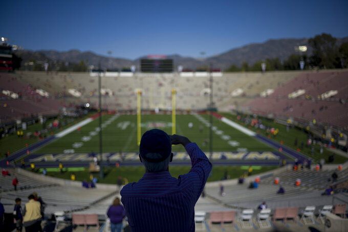 A fan arrives before the Rose Bowl NCAA college football game between Ohio State and Washington Tuesday, Jan. 1, 2019, in Pasadena, Calif. (AP Photo/Jae C. Hong)
