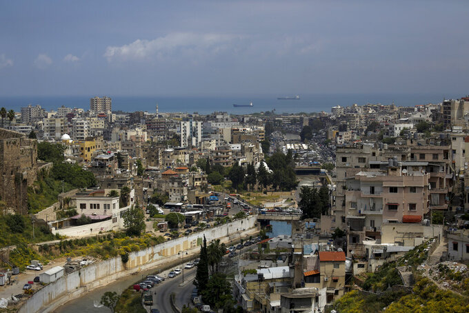 This Tuesday, May 5, 2020 photo, shows a partial view of the northern city of Tripoli, Lebanon. Residents of Lebanon's poorest city, Tripoli, despair as the country faces a terrifying confluence of events. An unprecedented economic crisis, nationwide protests and coronavirus restrictions are posing the biggest threat to stability since the end of the civil war in 1990. (AP Photo/Hassan Ammar)
