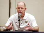 Purdue head coach Jeff Brohm answers questions during a news conference Thursday, Dec. 27, 2018, in Nashville, Tenn. Purdue is scheduled to face Auburn in the Music City Bowl NCAA college football game Friday. (AP Photo/James Kenney)
