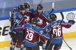 Colorado Avalanche players celebrate a goal against the Arizona Coyotes during the third period of a first-round NHL Stanley Cup playoff hockey game in Edmonton, Ontario, on Wednesday, Aug. 12, 2020. (Jason Franson/The Canadian Press via AP)