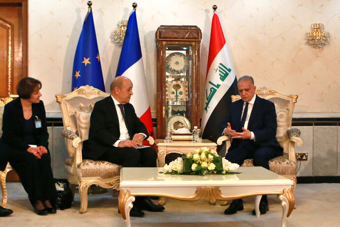 Iraqi Foreign Minister Mohamed Alhakim, right, meets with his visiting French counterpart Jean Yves Le Drian at the Ministry of Foreign Affairs in Baghdad, Iraq, Thursday, Oct. 17, 2019. (AP Photo/Khalid Mohammed)