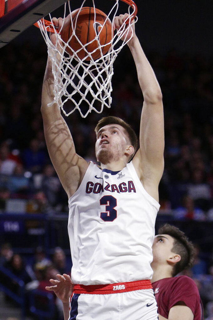 Gonzaga forward Filip Petrusev (3) dunks during the second half of an NCAA college basketball game against Santa Clara in Spokane, Wash., Saturday, Jan. 5, 2019. (AP Photo/Young Kwak)