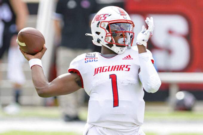 South Alabama quarterback Desmond Trotter (1) steps back to throw during an NCAA college football game against Louisiana-Lafayette in Lafayette, La., Saturday, Nov. 14, 2020. (AP Photo/Matthew Hinton)