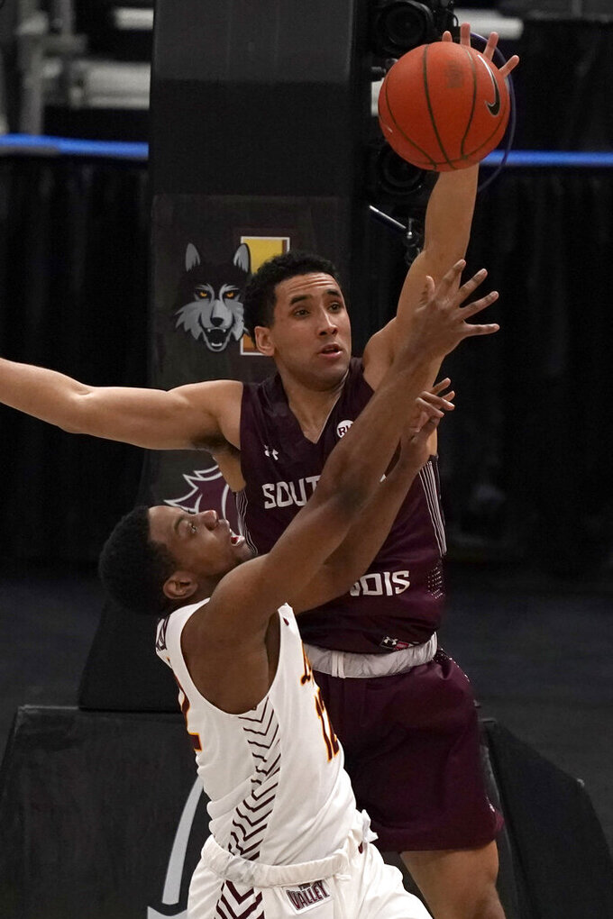Southern Illinois' Dalton Banks, top, and Loyola of Chicago's Marquise Kennedy reach for a rebound during the first half of an NCAA college basketball game in the quarterfinal round of the Missouri Valley Conference men's tournament Friday, March 5, 2021, in St. Louis. (AP Photo/Jeff Roberson)
