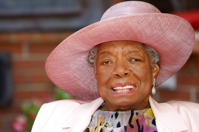 FILE - In this May 20, 2010 file photo, poet Maya Angelou smiles as she greets guests at a garden party at her home in Winston-Salem, N.C. How we address our elders and why set off a social media debate recently after a Los Angeles scriptwriter tweeted an old TV clip of Angelou rebuking a young woman for calling her by her first name. (AP Photo/Nell Redmond, File)