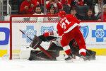Detroit Red Wings center Dylan Larkin (71) scores against Ottawa Senators goaltender Marcus Hogberg (35) during a shootout in an NHL hockey game Friday, Jan. 10, 2020, in Detroit. (AP Photo/Paul Sancya)