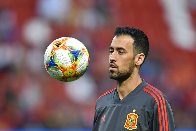 Spain's Sergio Busquets warms up before the Euro 2020 group F qualifying soccer match between Spain and Faroe Islands at the Molinon stadium in Gijon, Spain, Sunday, Sept. 8, 2019. (AP Photo/Alvaro Barrientos)