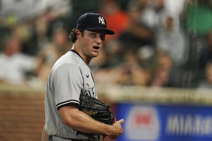 New York Yankees starting pitcher Gerrit Cole talks to himself while heading to the dugout after pitching to the Baltimore Orioles during the third inning of a baseball game, Tuesday, Sept. 14, 2021, in Baltimore. (AP Photo/Julio Cortez)