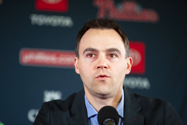 FILE - In this Dec. 16, 2019, file photo, Philadelphia Phillies general manager Matt Klentak speaks at an introductory news conference for new Phillies baseball players Zack Wheeler and Didi Gregorius in Philadelphia. Klentak has stepped down as general manager of the Phillies after a third straight September collapse left the team out of the postseason for the ninth consecutive season. (AP Photo/Matt Rourke, File)