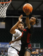 Houston guard DeJon Jarreau (3) shoots next to Georgia Tech forward James Banks III during the first half of an NCAA college basketball game Monday, Dec. 23, 2019, in Honolulu. (AP Photo/Marco Garcia)