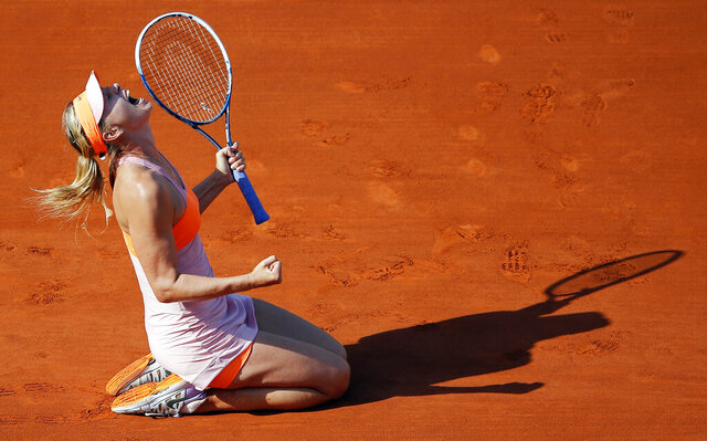 """FILE - In this Jule 7, 2014, file photo, Russia's Maria Sharapova reacts after defeating Romania's Simona Halep during their final match of the French Open tennis tournament at the Roland Garros stadium, in Paris, France. Sharapova is retiring from professional tennis at the age of 32 after five Grand Slam titles and time ranked No. 1. She has been dealing with shoulder problems for years. In an essay written for Vanity Fair and Vogue about her decision to walk away from the sport, posted online Wednesday, Feb. 26, 2020, Sharapova asks: """"How do you leave behind the only life you've ever known?"""" (AP Photo/David Vincent, File)"""
