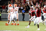 North Carolina State players, right, run on to the field after they defeated Clemson in double overtime at an NCAA college football game in Raleigh, N.C., Saturday, Sept. 25, 2021. (AP Photo/Karl B DeBlaker)