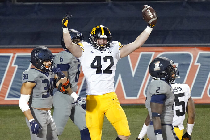 Iowa tight end Shaun Beyer celebrates his touchdown reception during the second half of an NCAA college football game against Illinois Saturday, Dec. 5, 2020, in Champaign, Ill.  (AP Photo/Charles Rex Arbogast)