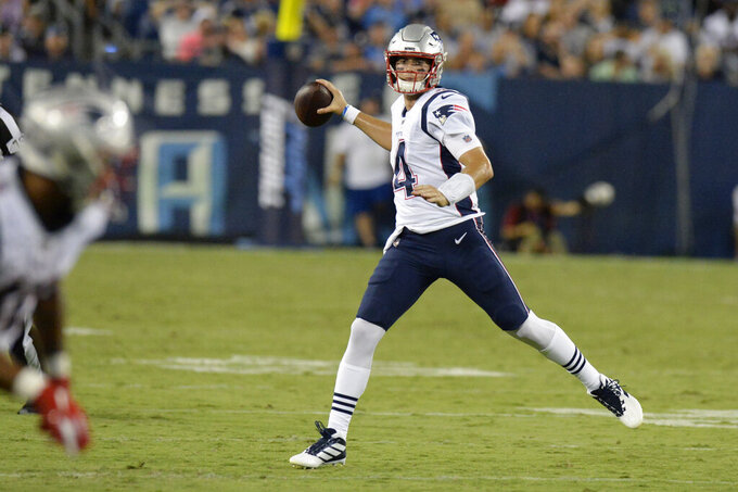 New England Patriots quarterback Jarrett Stidham (4) passes against the Tennessee Titans in the second half of a preseason NFL football game Saturday, Aug. 17, 2019, in Nashville, Tenn. (AP Photo/Mark Zaleski)