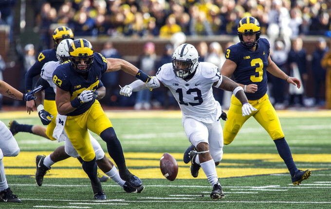 Penn State linebacker Ellis Brooks (13) battles with Michigan tight end Zach Gentry (83) for a loose football after a blocked field goal attempt by kicker Quinn Nordin (3) in the second quarter of an NCAA college football game in Ann Arbor, Mich., Saturday, Nov. 3, 2018. (AP Photo/Tony Ding)