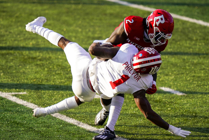 Rutgers defensive back Avery Young (2) tackles Indiana wide receiver Whop Philyor (1) during the second quarter of an NCAA college football game Saturday, Oct. 31, 2020, in Piscataway, N.J. (AP Photo/Corey Sipkin)
