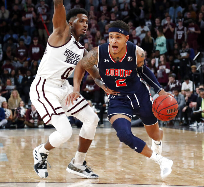 Auburn guard Bryce Brown (2) dribbles against Mississippi State guard Nick Weatherspoon (0) during the second half of an NCAA college basketball game in Starkville, Miss., Saturday, Jan. 26, 2019. (AP Photo/Rogelio V. Solis)