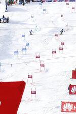 Slovakia's Petra Vlhova, left, and Sweden's Anna Swenn-larsson compete during an alpine ski, women's parallel slalom World Cup in St. Moritz, Switzerland, Sunday, Dec. 15, 2019. (AP Photo/Alessandro Trovati)