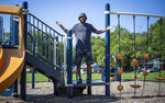 ADVANCE FOR PUBLICATION ON SUNDAY, AUG. 22, AND THEREAFTER - Dee Ross, founder of the Dee Ross Foundation, stands on a playground Monday, Aug. 2, 2021, named in his honor, in Indianapolis. The park is just the beginning for the land that sits behind the soon-to-open Ross Center East, a community center for nearby residents. Ross hopes to build a splash pad and basketball courts in the future. (Mykal McEldowney/The Indianapolis Star via AP)