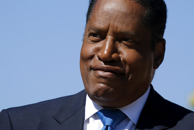 Republican conservative radio show host Larry Elder speaks at a rally for the California gubernatorial recall election on Monday, Sept. 13, 2021, in Monterey Park, Calif. (AP Photo/Ringo H.W. Chiu)