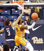Pittsburgh's Jared Wilson-Frame (4) gets by Notre Dame's Prentiss Hubb (3) to shoot during the second half of an NCAA college basketball game, Saturday, March 9, 2019, in Pittsburgh. Pittsburgh won 56-53. (AP Photo/Keith Srakocic)