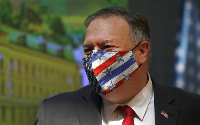 U.S. Secretary of State Mike Pompeo wears a face mask during a joint press conference as part of a meeting with the Prime Minister of Czech Republic Andrej Babis in Prague, Czech Republic, Wednesday, Aug. 12, 2020. U.S. Secretary of State Mike Pompeo is in Czech Republic at the start of a four-nation tour of Europe. Slovenia, Austria and Poland are the other stations of the trip. (AP Photo/Petr David Josek, Pool)