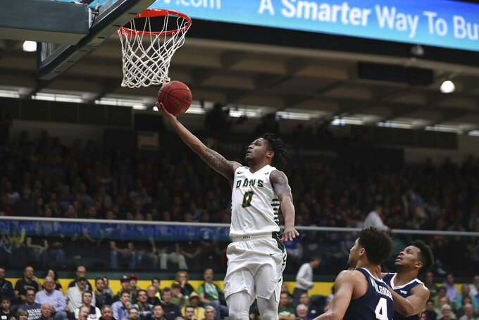 San Francisco guard Khalil Shabazz (0) shoots against Gonzaga guard Ryan Woolridge (4) during the first half of an NCAA college basketball game in San Francisco, Saturday, Feb. 1, 2020. (AP Photo/Jed Jacobsohn)
