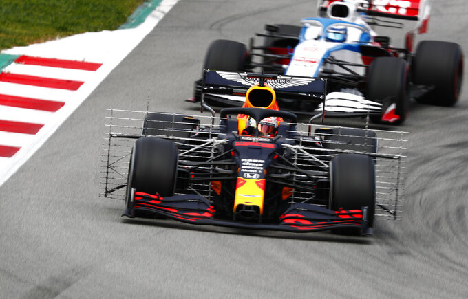 Red Bull driver Max Verstappen, front, of the Netherlands and Williams driver Nicholas Latifi of Canada steer their cars during the Formula One pre-season testing session at the Barcelona Catalunya racetrack in Montmelo, outside Barcelona, Spain, Thursday, Feb. 27, 2020. (AP Photo/Joan Monfort)