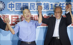 Kaohsiung city mayor Han Kuo-yu, left, celebrates with Wu Den-yih, chairman of the opposition National Party (KMT), during a media event after winning the candidacy of the opposition of the Nationalist Party (KMT) for the upcoming presidential elections at the party headquarters, Monday, July 15, 2019, in Taipei, Taiwan. (AP Photo/Chiang Ying-ying)