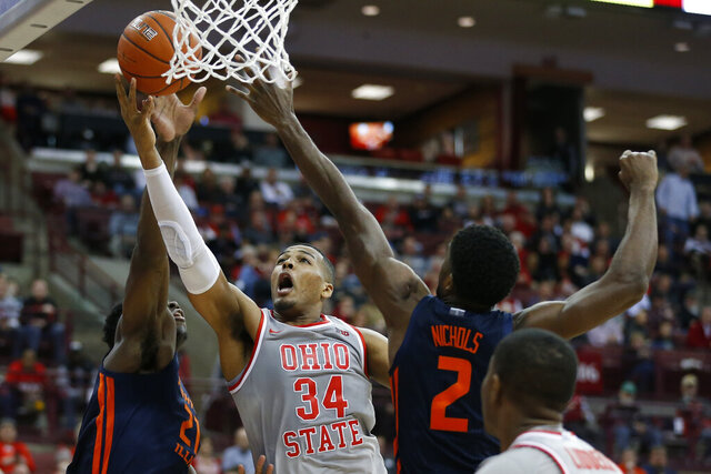 Ohio State's Kaleb Wesson, center, shoots between Illinois' Kofi Cockburn, left, and Kipper Nichols during the second half of an NCAA college basketball game Thursday, March 5, 2020, in Columbus, Ohio. Ohio State won 71-63. (AP Photo/Jay LaPrete)