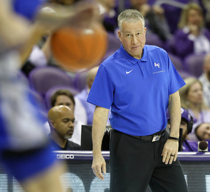 Air Force head coach Dave Pilipovich watches action in the first half of an NCAA college basketball game against TCU in Fort Worth, Texas, Monday, Nov. 18, 2019. (Bob Booth/Star-Telegram via AP)
