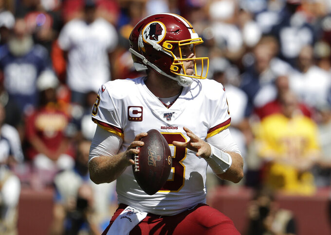 Washington Redskins quarterback Case Keenum looks downfield to pass the ball in the first half of an NFL football game against the Dallas Cowboys, Sunday, Sept. 15, 2019, in Landover, Md. (AP Photo/Evan Vucci)