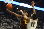 Minnesota's Marcus Carr (5) drives to the basket on Penn State's Lamar Stevens (11) during late first-half action of an NCAA college basketball game, Saturday, Feb. 8, 2020, in State College, Pa. (AP Photo/Gary M. Baranec)