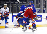 New York Rangers' Jacob Trouba (8) checks New York Islanders' Mathew Barzal during the third period of an NHL hockey game Saturday, Jan. 16, 2021, in New York. (Bruce Bennett/Pool Photo via AP)