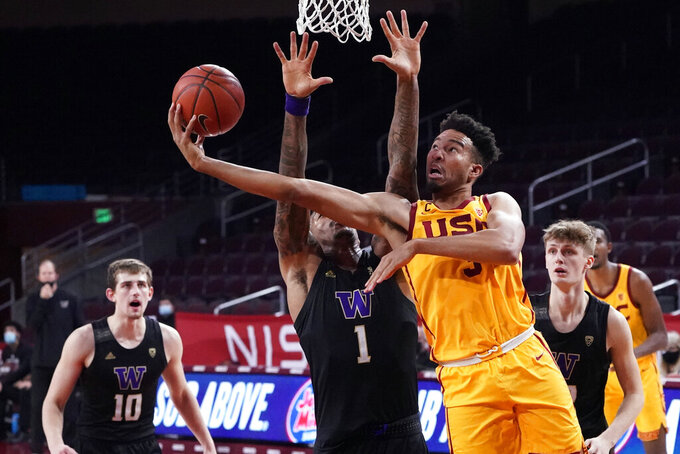Southern California forward Isaiah Mobley, right, scores over Washington forward Nate Roberts (1) during the second half of an NCAA college basketball game Thursday, Jan. 14, 2021, in Los Angeles. (AP Photo/Marcio Jose Sanchez)