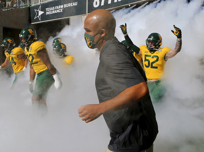 Baylor coach Dave Aranda takes the field with his team before an NCAA college football game against TCU in Waco, Texas, Saturday, Oct. 31, 2020. (Jerry Larson/Waco Tribune-Herald via AP)