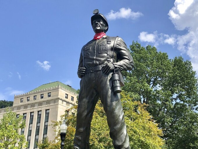 A statue of a coal miner is shown Thursday, Aug. 26, 2021, at the West Virginia Capitol in Charleston, W.Va. This weekend, marchers are retracing the steps of thousands of coal miners who participated in the Battle of Blair Mountain in southern West Virginia. At least 16 men died in the largest U.S. armed uprising since the Civil War before the miners surrendered to federal troops in early September 1921. (AP Photo/John Raby)