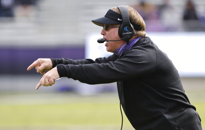 TCU head coach Gary Patterson gestures to his team as TCU plays Oklahoma State during the first half of an NCAA college football game Saturday, Dec. 5, 2020, in Fort Worth, Texas. (AP Photo/Ron Jenkins)