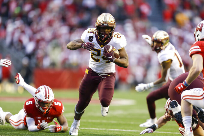 FILE - In this Nov. 24, 2018, file photo, Minnesota running back Mohamed Ibrahim (24) runs past Wisconsin cornerback Rachad Wildgoose (5) during the first half of an NCAA college football game, in Madison, Wis. Minnesota takes a stacked offense and increased confidence into the third season under coach P.J. Fleck, but the Gophers better be prepared for their opener against neighbor South Dakota State, which is ranked fourth in the FCS poll. (AP Photo/Andy Manis, File)