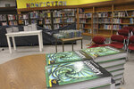 This June 14, 2019, photo shows the library at Wasilla Middle School in Wasilla, Alaska, that would be available to lawmakers. Alaska Gov. Mike Dunleavy has called lawmakers into special session in Wasilla beginning July 8, but some lawmakers have expressed concerns over security and logistics with the location more than 500 miles from the state capital of Juneau, Alaska. (AP Photo/Mark Thiessen)