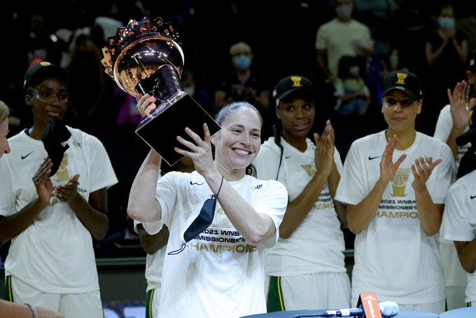 Seattle Storm guard Sue Bird holds the champions trophy after the Commissioner's Cup WNBA basketball game against the Connecticut Sun, Thursday, Aug. 12, 2021, in Phoenix. (AP Photo/Matt York)