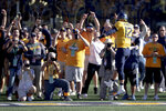 West Virginia quarterback Austin Kendall (12) scores a touchdown against Texas during an NCAA college football game on Saturday, Oct. 5, 2019, in Morgantown, W.Va.  (Nick Wagner/Austin American-Statesman via AP)