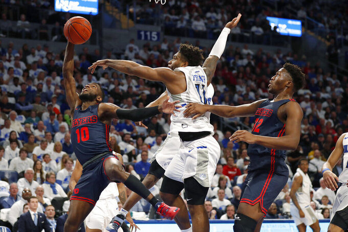 Dayton's Jalen Crutcher (10) has the ball knocked away by Saint Louis' Hasahn French (11) as Dayton's Jordy Tshimanga (32) watches during the first half of an NCAA college basketball game Friday, Jan. 17, 2020, in St. Louis. (AP Photo/Jeff Roberson)