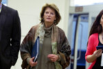 Sen. Lisa Murkowski, R-Alaska, walks to the Senate chamber, on Capitol Hill in Washington, Wednesday, Jan. 22, 2020, to attend the impeachment trial of President Donald Trump on charges of abuse of power and obstruction of Congress. (AP Photo/Jose Luis Magana)