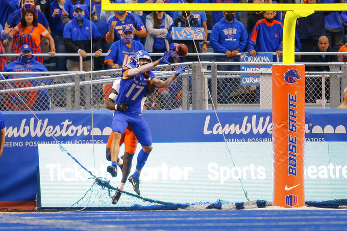 Boise State wide receiver Davis Koetter (17) reaches back for the ball on a touchdown reception against Oklahoma State during the first half of an NCAA college football game Saturday, Sept. 18, 2021, in Boise, Idaho. (AP Photo/Steve Conner)